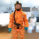 Millbrook engineer wearing Personal Protective Equipment in vehicle testing facility