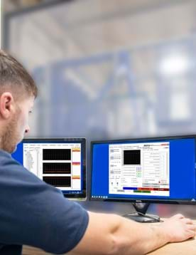 Engineer using Millbrook's RE pro system cell software in test laboratory