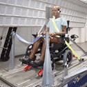 Crash test dummy for wheelchair testing in Millbrook's Sled facility