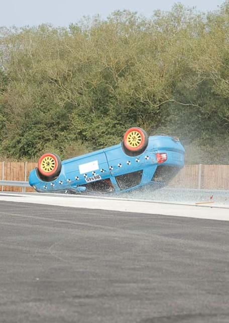Rollover crash test against FMVSS 208 test procedure at Millbrook