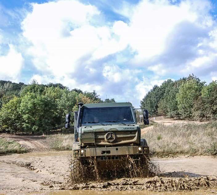Military vehicle testing on the off-road tracks wading pond at DVD at Millbrook Proving Ground