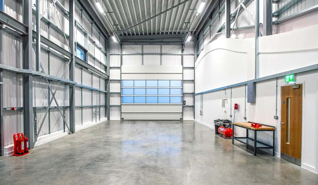 Interior view of a large vehicle workshop to rent at Millbrook Technology Park