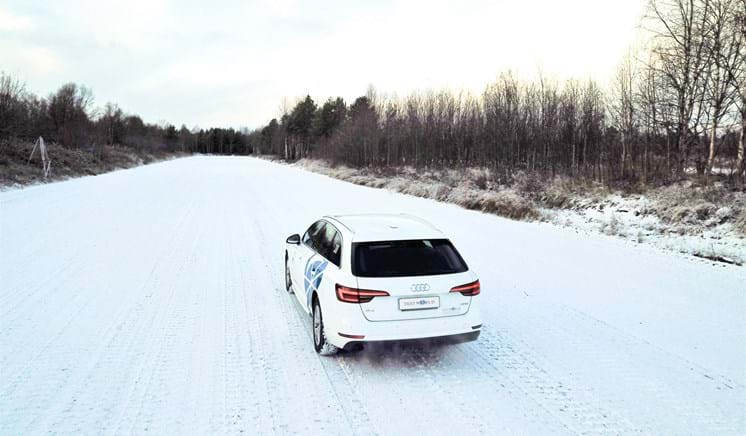 Car driving after first snowfall of 2020 winter season at Millbrook's Test World in Finland