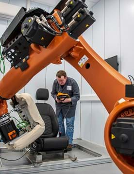 KUKA robot performing ingress/egress testing in an automotive seat testing laboratory at Millbrook