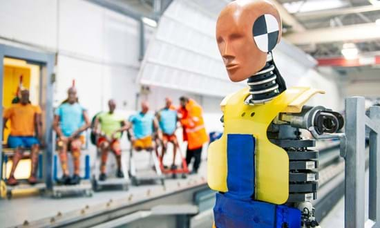 Millbrook sled laboratory with selection of dummies to test rail interior crashworthiness
